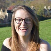 Eve smiling on a hillside