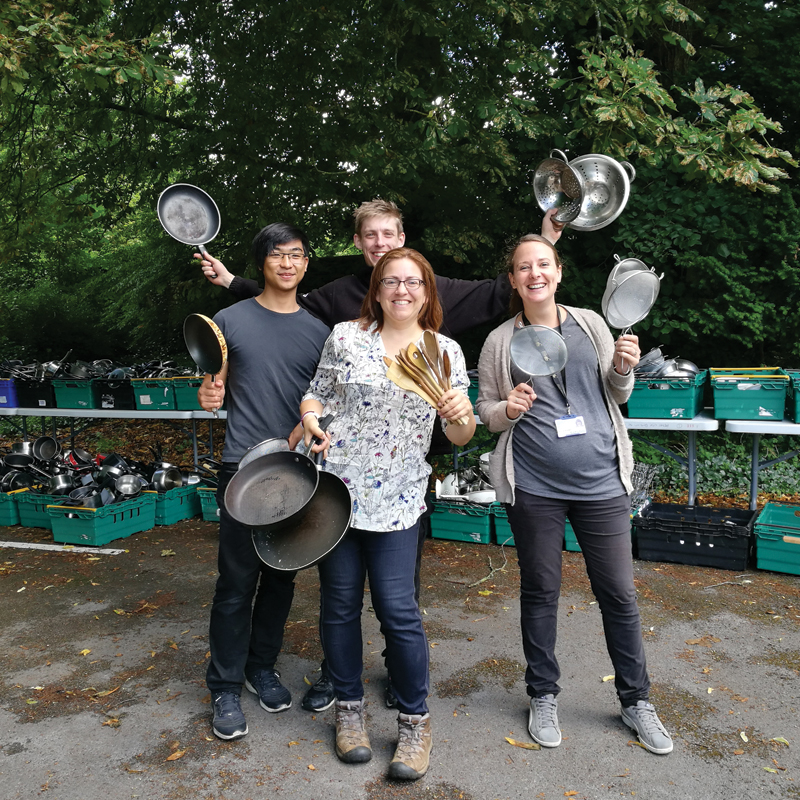 People holding pots and pans