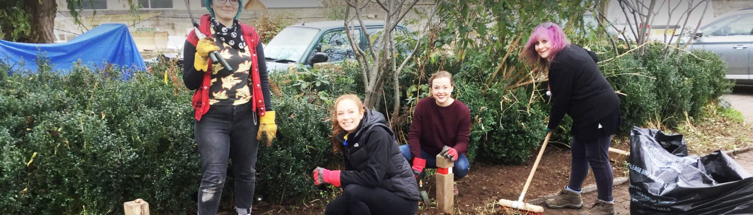 Student and residents gardening together